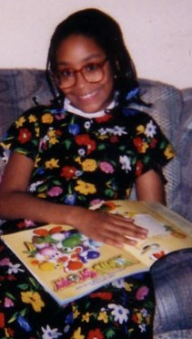 Check out the Yoshi's Story Player's Guide and my geeky glasses with goofy dress. Gotta love the 90's!